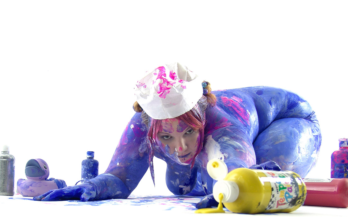 Big Beautiful woman covered in paint